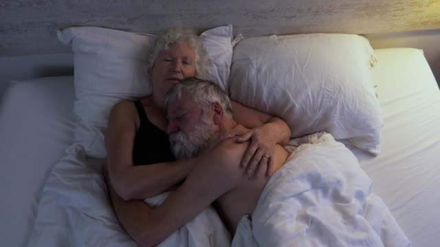 senior couple in bed together - photograph stock videos & royalty-free footage