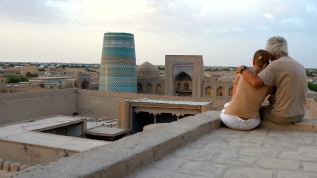 senior couple in khiva  at sun rise - surrounding wall stock videos & royalty-free footage