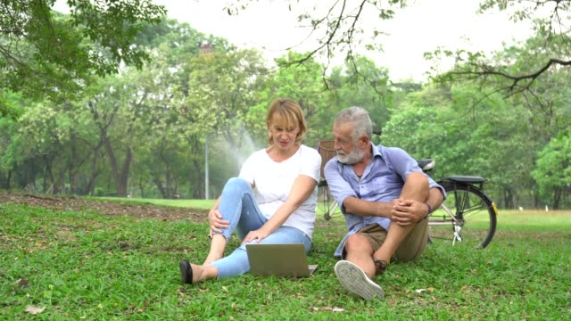 senior couple in love enjoying togetherness at park ,retired couple walking in the park together - hugging self stock videos & royalty-free footage