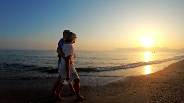 senior couple in love walking on the beach - photography stock videos & royalty-free footage