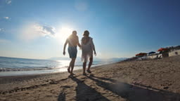 Senior couple in love walking on the beach
