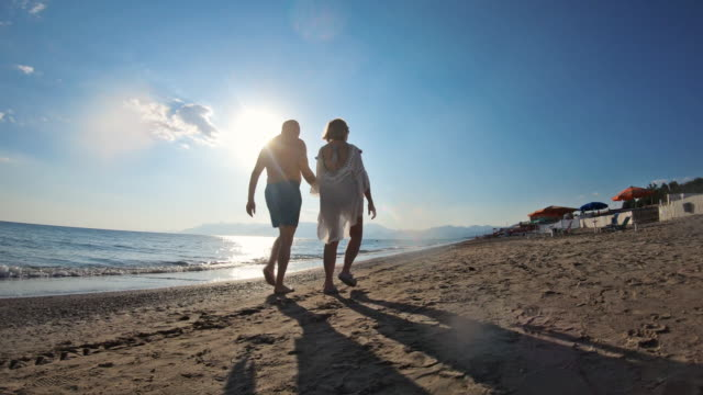 senior couple in love walking on the beach - falling in love stock videos & royalty-free footage