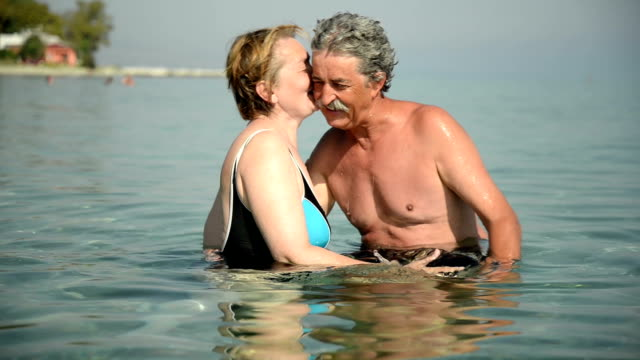 senior couple in the sea - senior couple stock videos and b-roll footage
