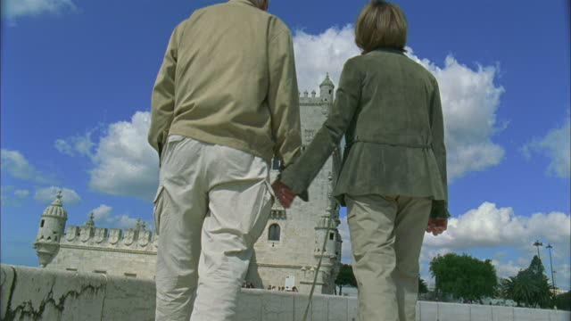 MS, LA, Senior couple kissing in front of Belem tower, Lisbon, Portugal