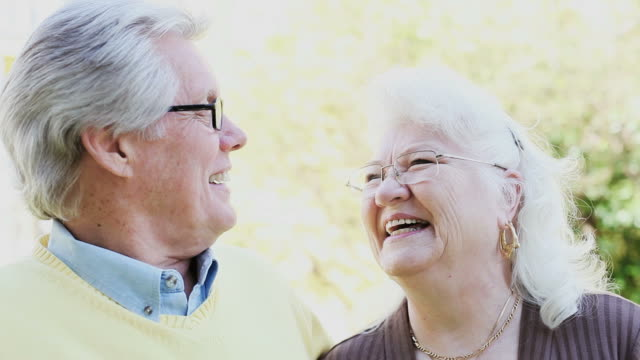 senior couple laughing - sideways glance stock videos & royalty-free footage