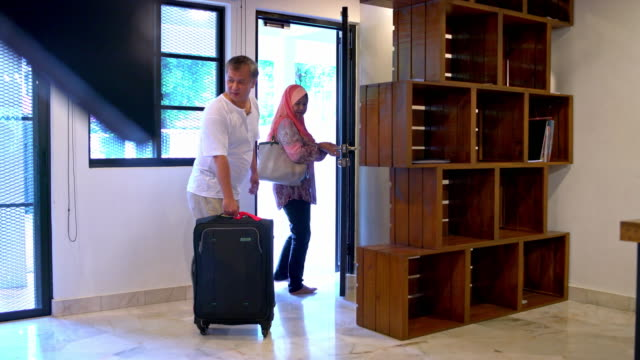 senior couple leaving home whit suitcase - hijab stock videos and b-roll footage