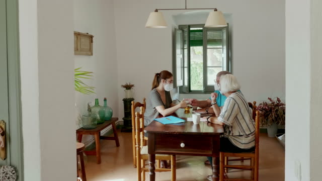 senior couple listening to insurance sales pitch at home - sales pitch stock videos & royalty-free footage
