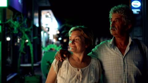 senior couple looking shop window display - window display stock videos & royalty-free footage