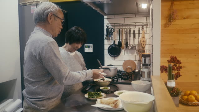 senior couple making toshikoshi soba year-crossing noodles in the kitchen - seaweed stock videos & royalty-free footage