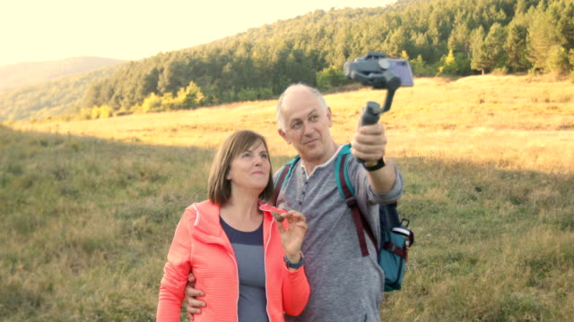 senior couple making video with smartphone gimbal - respect stock videos & royalty-free footage