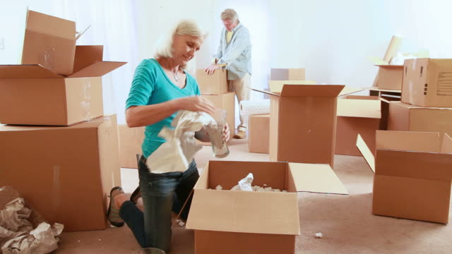 senior couple moving - relocation stock videos & royalty-free footage