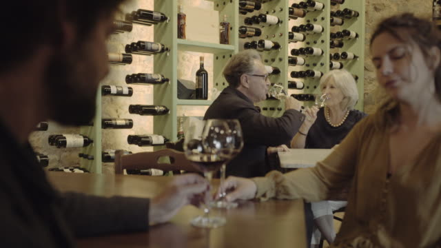 senior couple on a date in wine bar - wine bar stock videos & royalty-free footage