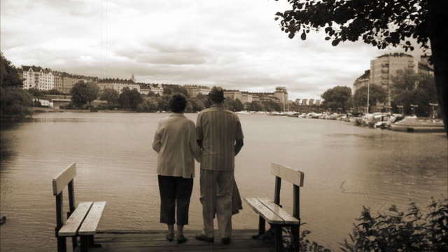 a senior couple on a jetty stockholm sweden. - sepia stock videos and b-roll footage