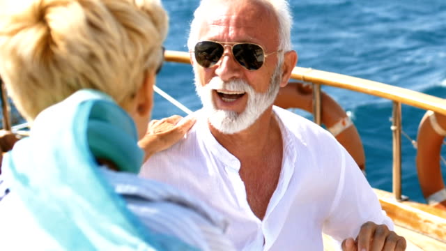 senior couple on a sailing cruise. - beard stock videos & royalty-free footage