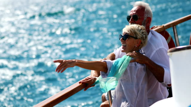 senior couple on a sailing cruise. - terza età video stock e b–roll