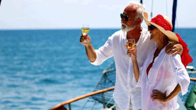 stockvideo's en b-roll-footage met senior paar op een zeilen cruise. - alcohol