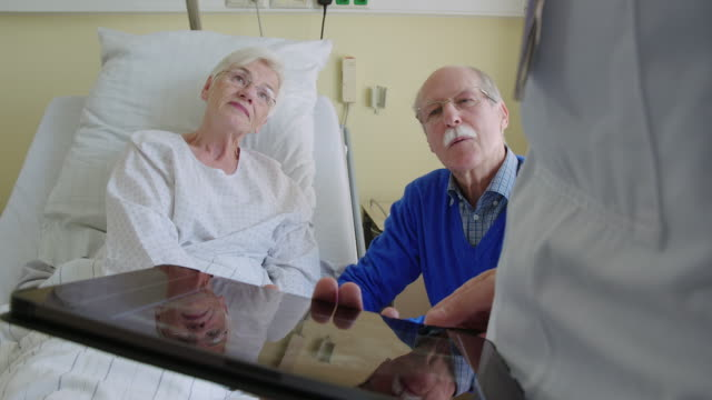 senior couple on bed during doctor's visit - radiologist stock videos & royalty-free footage