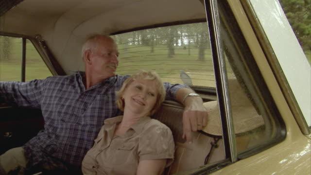 MS, Senior couple on car back seat, Tamborine Mountain, Brisbane, Queensland, Australia