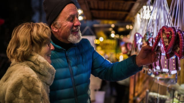 senior couple on christmas market - active seniors stock videos & royalty-free footage