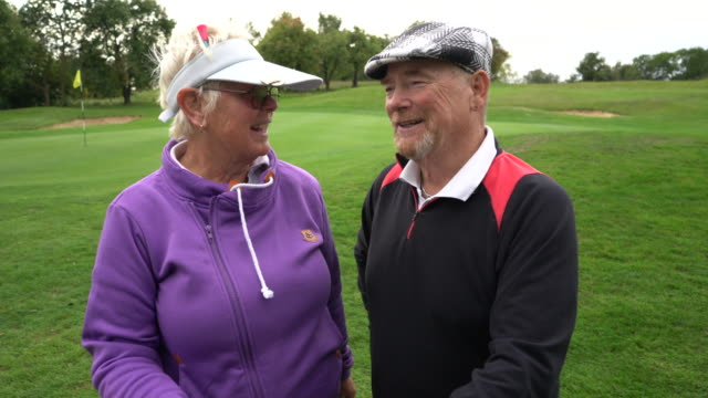 a senior couple on the golf course. - sun visor stock videos and b-roll footage