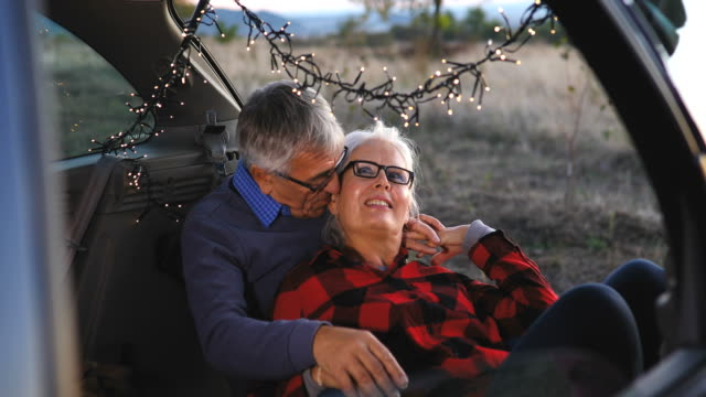 senior couple outdoors with car - boot stock videos & royalty-free footage