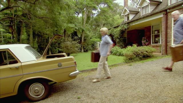 ws, senior couple packing old fashion suitcases into car, tamborine mountain, brisbane, queensland, australia - driveway stock videos & royalty-free footage