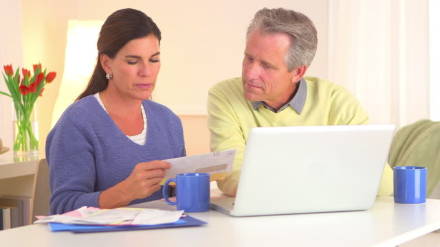 Senior couple paying bills