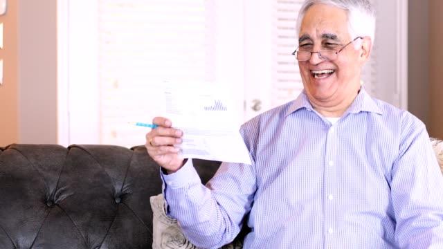 Senior couple pays bills electronically