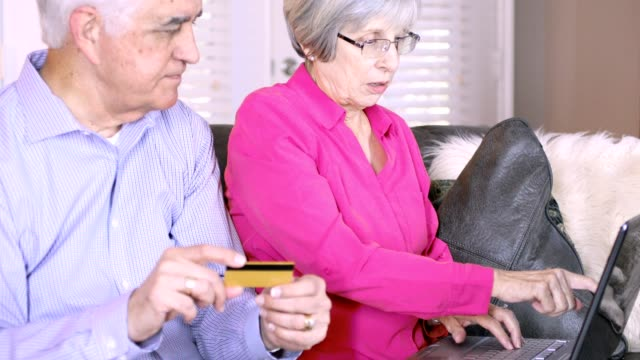 Senior couple pays bills electronically