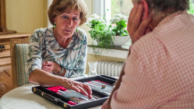 Senior couple playing a board game - Social Seniors