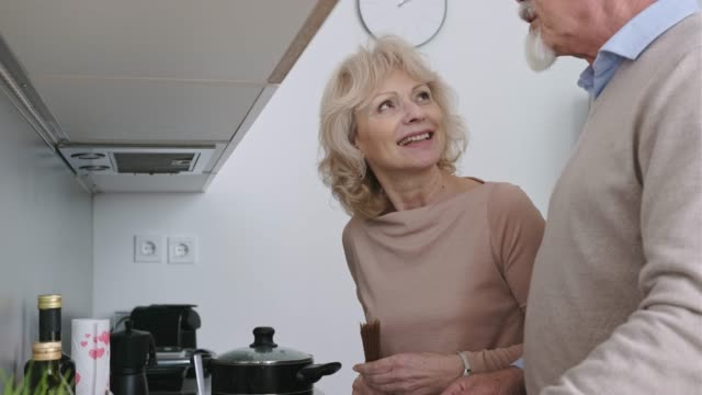 senior couple preparing dinner - 60 64 years stock videos & royalty-free footage