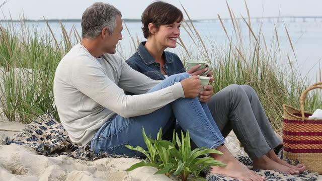 senior couple relaxing on a beach