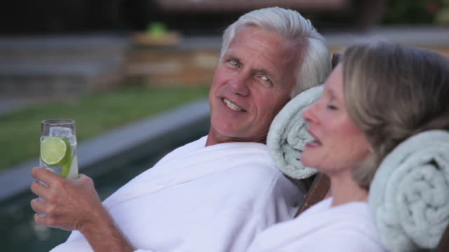 cu pan senior couple relaxing on lounge chairs by swimming pool / richmond, virginia, usa - 10 seconds or greater stock videos & royalty-free footage