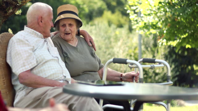 senior couple relaxing outdoors - enjoyment stock videos & royalty-free footage