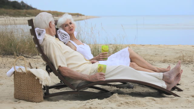 ms senior couple relaxing together on beach, eastville, virginia, usa - eastville stock videos and b-roll footage
