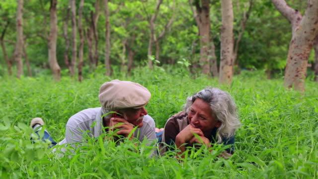 Senior couple romancing in the park, Delhi, India