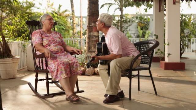 senior couple romancing  - balcony stock videos & royalty-free footage