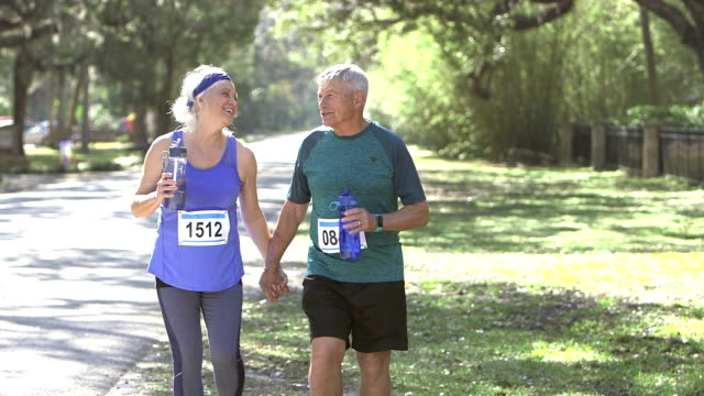 Senior couple, runners after race