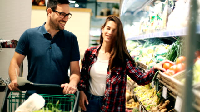 senior couple shopping in supermarket - leaf vegetable stock videos & royalty-free footage