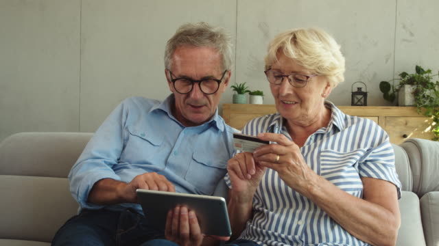 senior couple shopping online - retirement stock videos & royalty-free footage