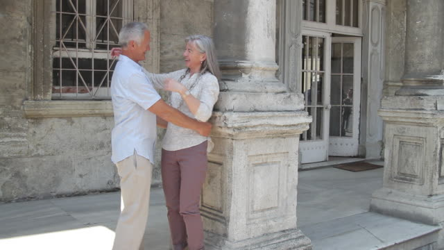 senior couple sight seeing and embracing each other - falling in love stock videos & royalty-free footage