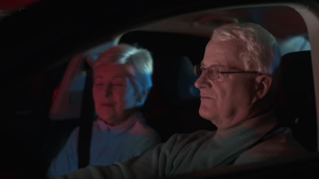 hd dolly: senior couple singing in a car - singing stock videos and b-roll footage