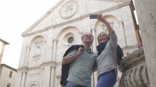 senior couple siteseeing - photographing self stock videos & royalty-free footage