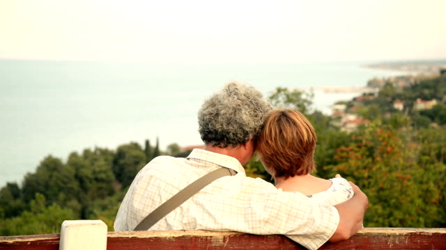 senior couple sitting on the bench - memories stock videos and b-roll footage