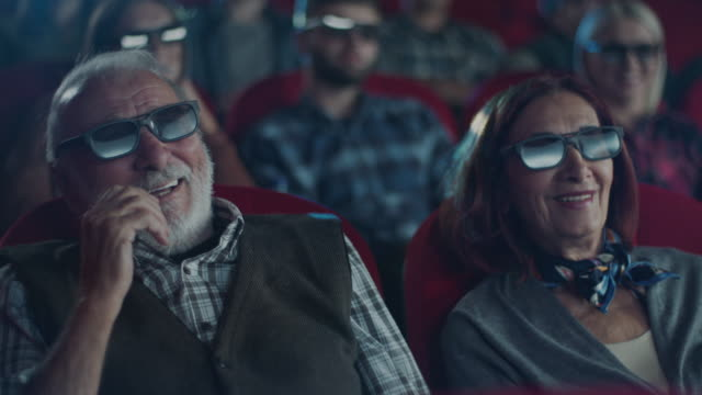 senior couple smiling at cinema - cinema stock videos & royalty-free footage