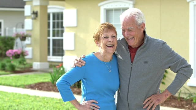 senior couple standing together outside their home - in front of stock videos & royalty-free footage