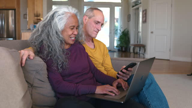 senior couple staying in touch with family and friends - pacific islanders stock videos & royalty-free footage