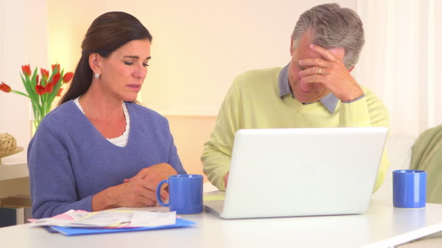 Senior couple stressing over bills