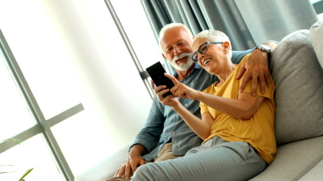 senior couple taking selfies at home. - active seniors stock videos & royalty-free footage