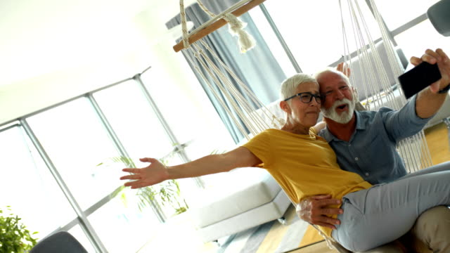 senior couple taking selfies at home. - short hair stock videos & royalty-free footage